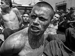 MS 13 boy looking backward